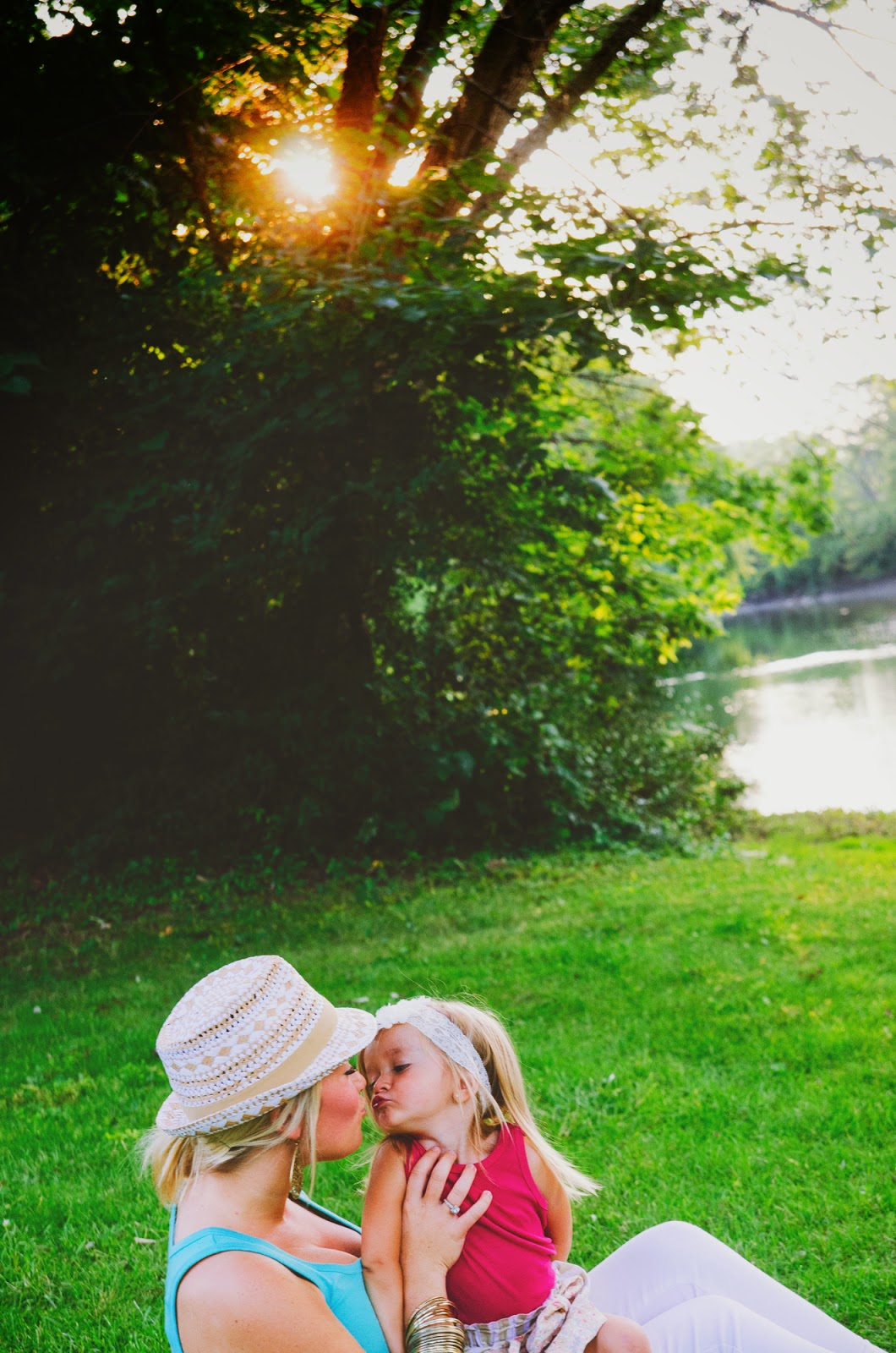sweet kisses in backlit photo from indianapolis family photographer