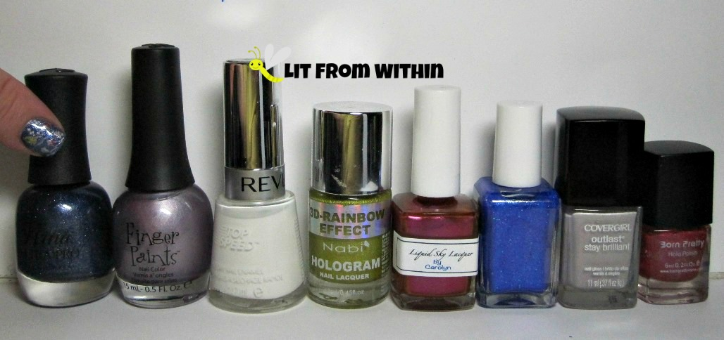 Bottle shot:  Nina Ultra Pro Twinkle Twinkle, Finger Paints Silver Sculpture, Revlon Spirit, Nabi Gold, Liquid Sky Lacquer Marisa Lander's Dancing Flames, Blue-Eyed Girl Lacquer 2014, Cover Girl Silver Lining, and Born Pretty Holo #3.