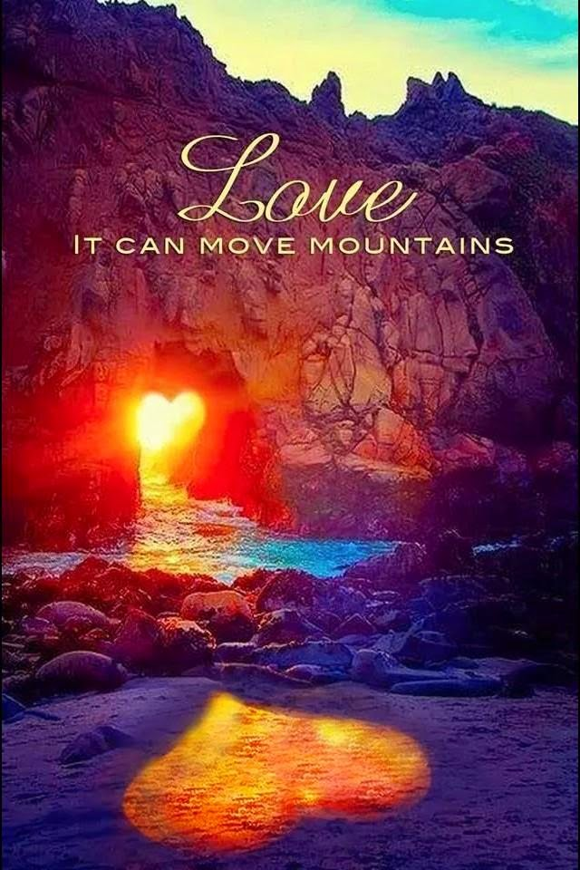 """Love. It can move mountains."" Picture of a mountain with a heart shaped hole in it with the sun shining through and a heart shaped shadow on the beach."
