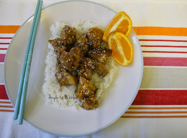 A plate of gluten-free sesame orange chicken from www.anyonita-nibbles.com