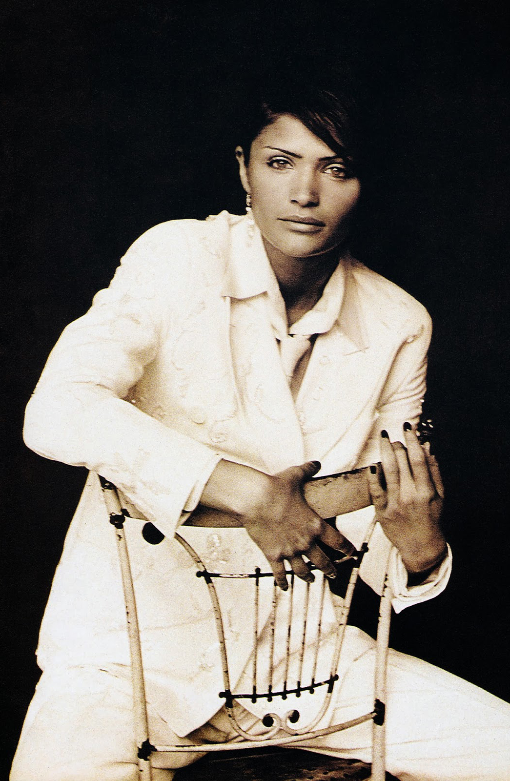 Helena Christensen in Dolce&Gabbana menswear inspired suit by Jacques Olivar in Marie Claire August 1993 editorial