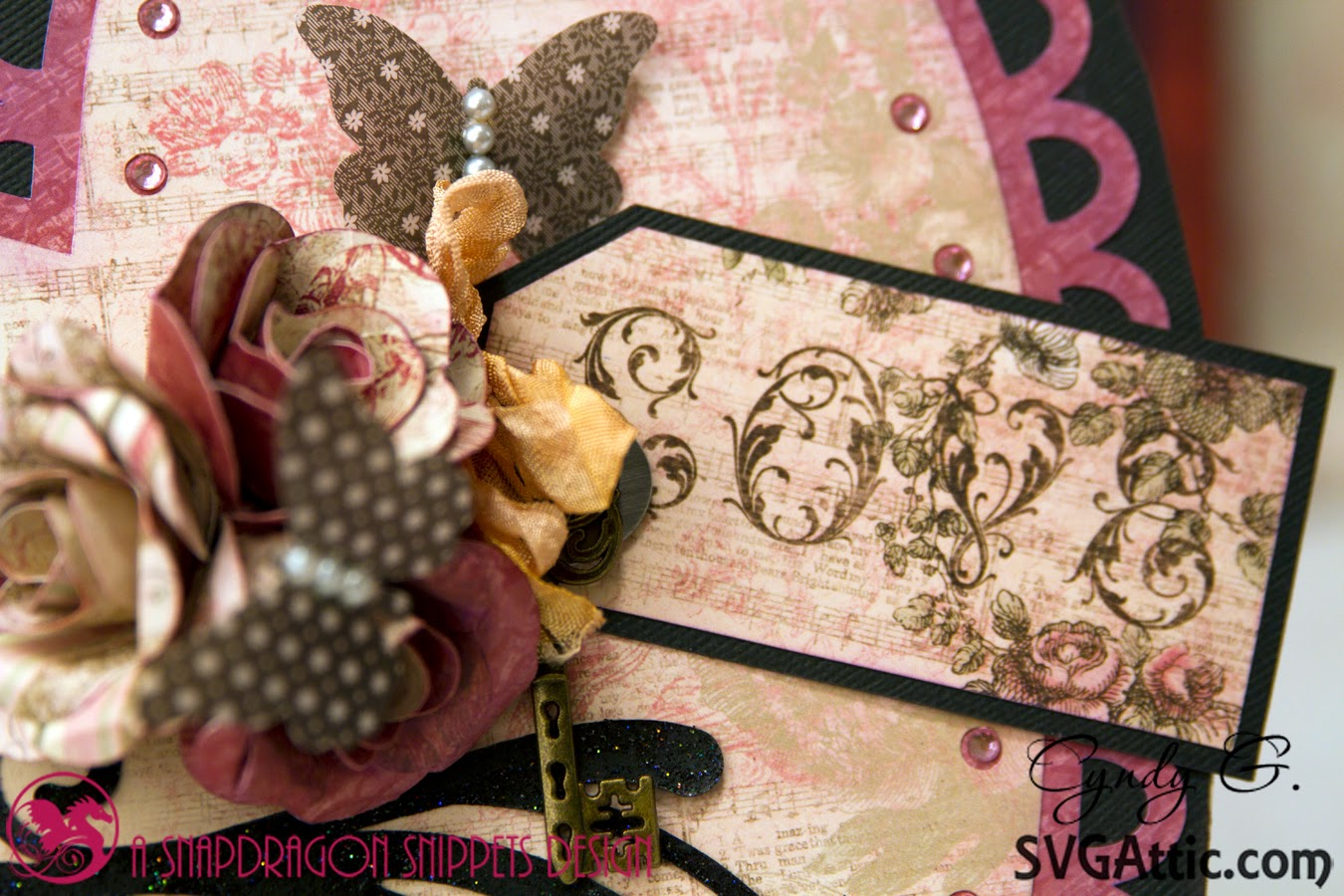 Close up of love tag and flowers on heart shaped box