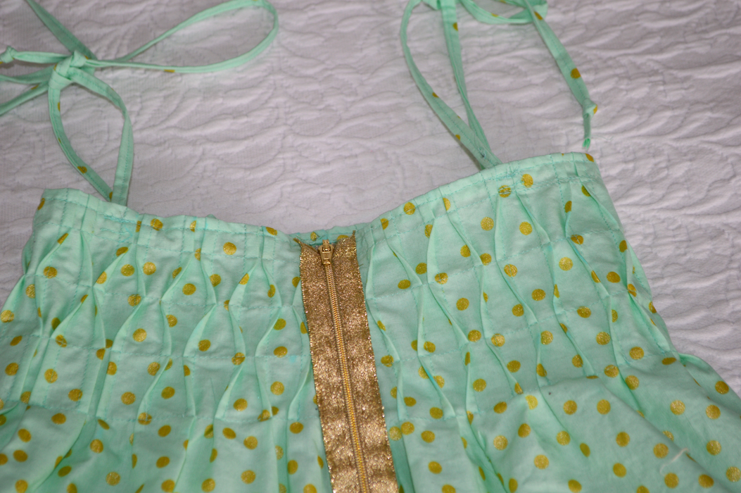 Mint and gold smocked sundress sewn by Cicely Ingleside