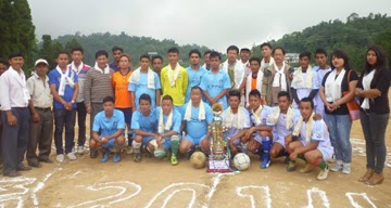 Players and guests pose for a photo-opp on the inaugural day of the late Arpana Bomzon Memorial Knockout Football Tournament in Mirik on Wednesday.