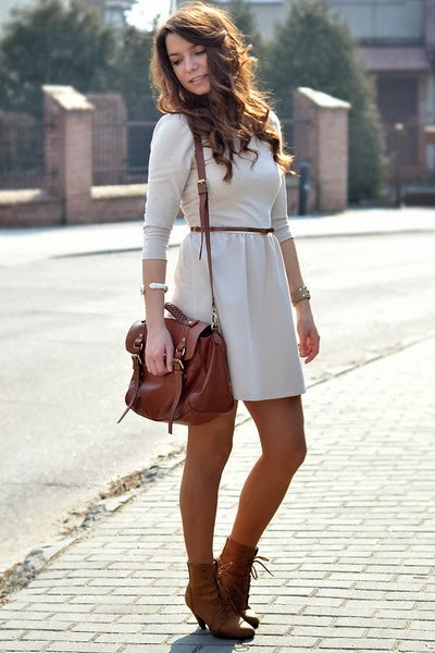 white dress with hand bag and boots