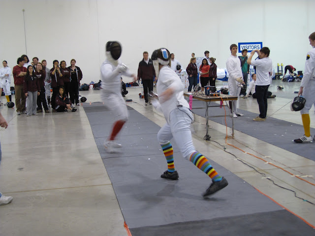 A fencing match in action