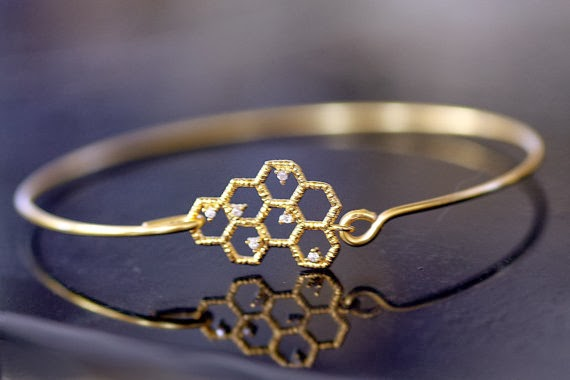 https://www.etsy.com/listing/162188452/bee-hive-gold-bangle-gold-bracelet-gold?ref=sr_gallery_23&ga_search_query=bee+jewelry&ga_order=most_relevant&ga_view_type=gallery&ga_ship_to=US&ga_page=4&ga_search_type=handmade&ga_facet=handmade%2Fjewelry%2Fbracelet