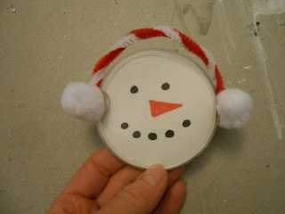 Snaowman ornament from a plastic lid