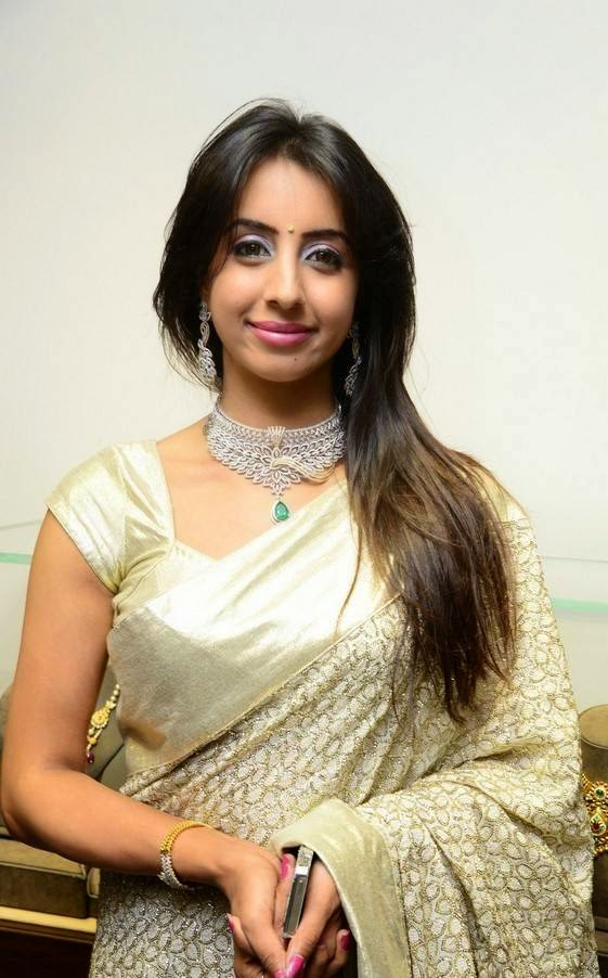 Sanjjanaa in Saree At Hiya Jewellers Curtain Raiser Event