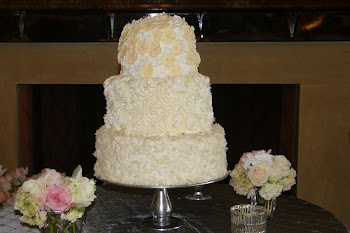 3-tier round coconut, buttercream, and edible flowers