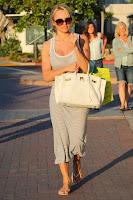 Pamela Anderson white purse