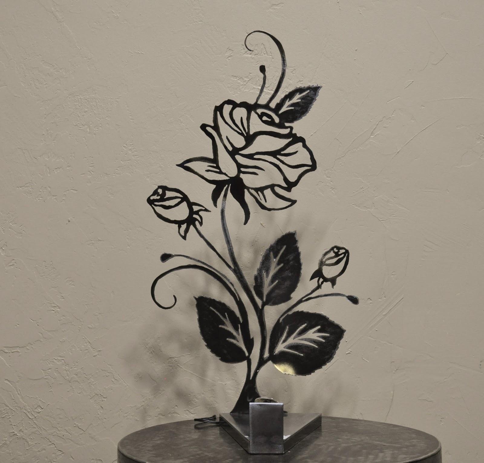 cr ateur d 39 objets d co en fer forg bougeoirs luminaires porte bouteille lampe entre ombre. Black Bedroom Furniture Sets. Home Design Ideas