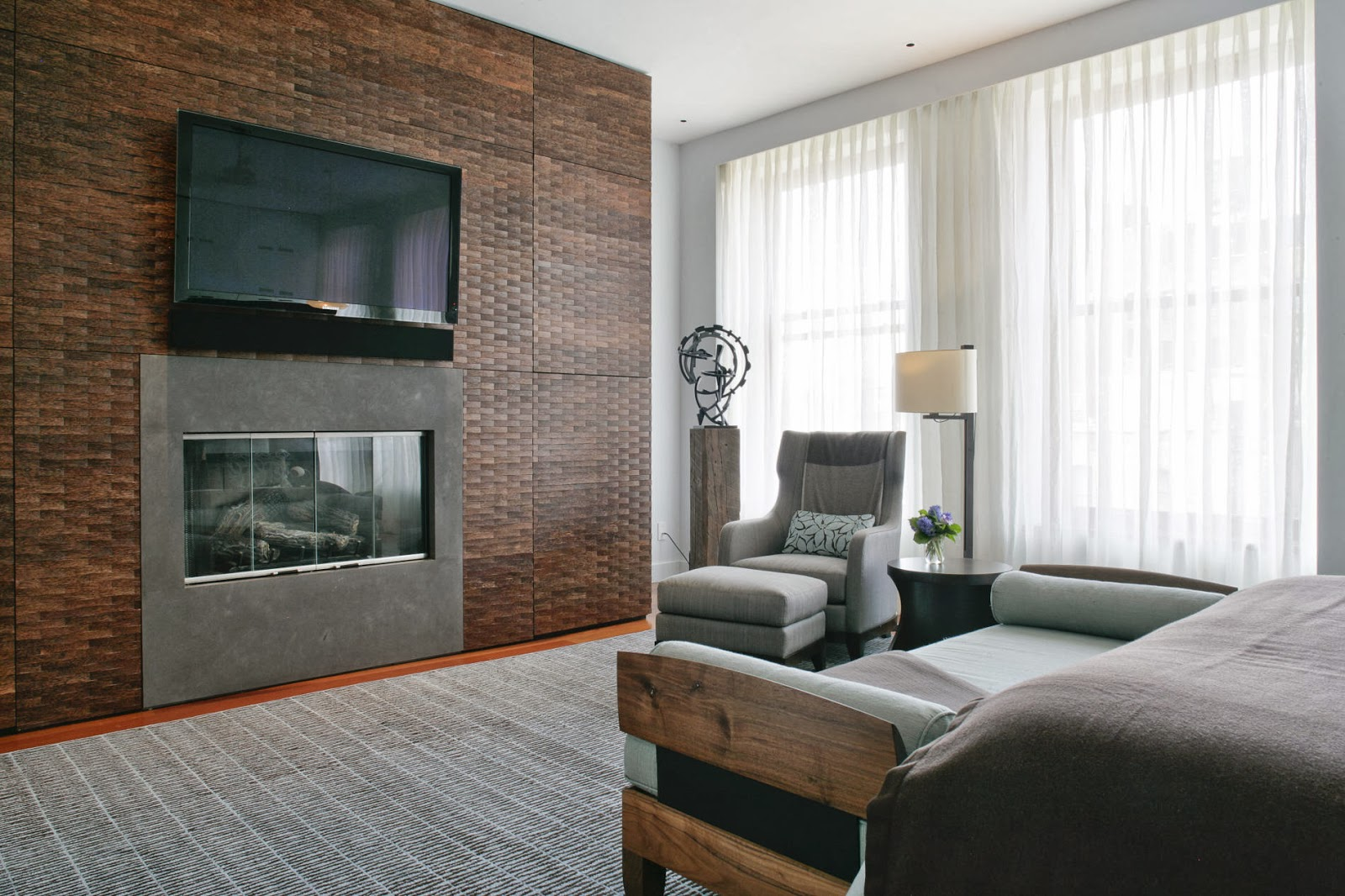 modern master bedroom in monochromatic palette and a lovely accent wicker board wall