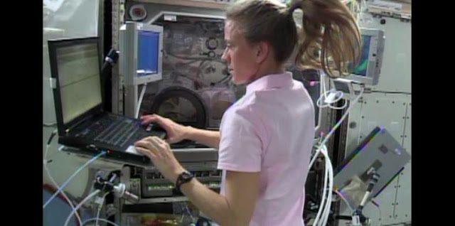 Flight Engineer Karen Nyberg checks procedures on a laptop computer as she prepares to conduct another session of the InSPACE-3 experiment aboard the International Space Station. Image Credit: NASA TV