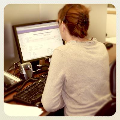 GotPrint customer service representative by computer screen looking at an order