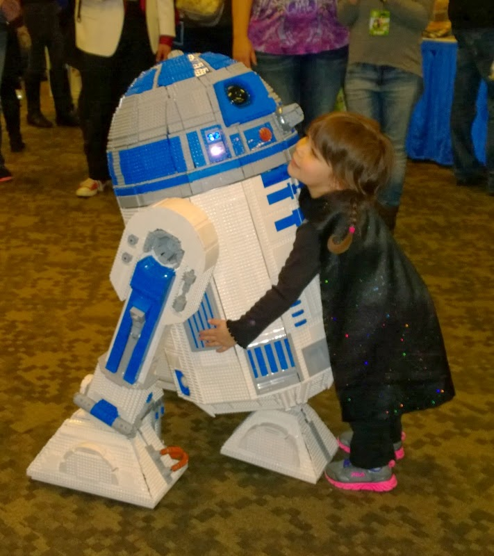 Darth Lily comforting R2-D2 after she scared him so badly