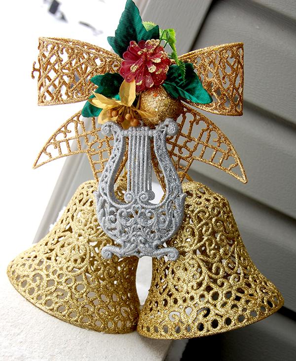 gold ribbon, gold bells and silver harp wall decor