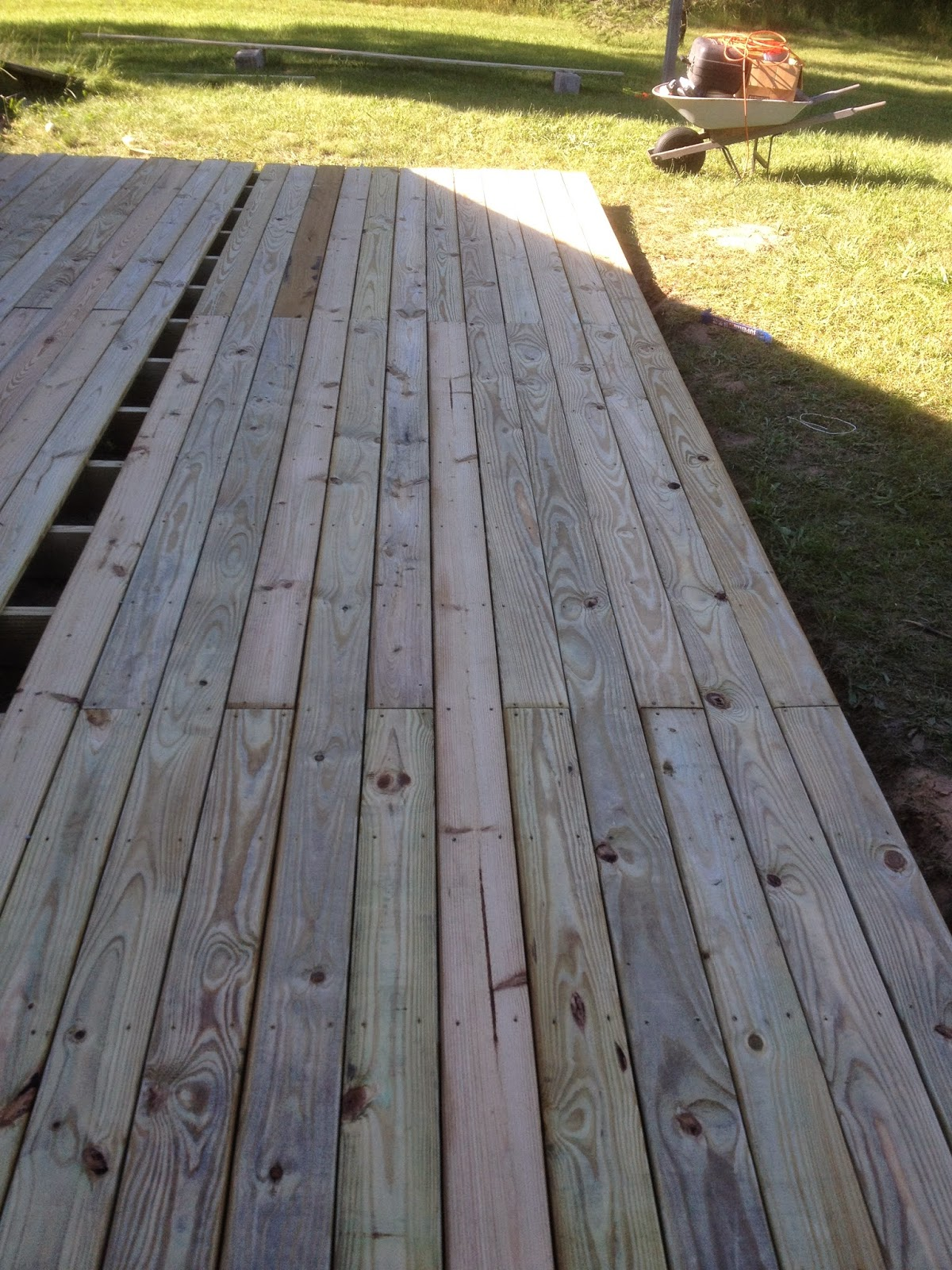 From Dirt to Deck How to Build a Ground Level Deck