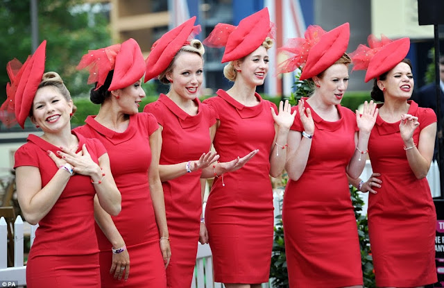 The Tootsie Rollers in vintage red dresses on day one of Royal Ascot, 2013