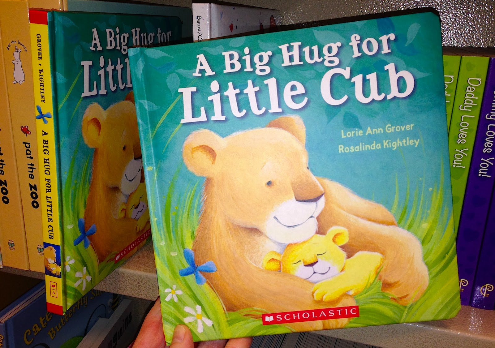 http://www.amazon.com/Big-Hug-Little-Lorie-Grover/dp/0545530911/ref=sr_1_1?s=books&ie=UTF8&qid=1393546164&sr=1-1&keywords=grover+cub