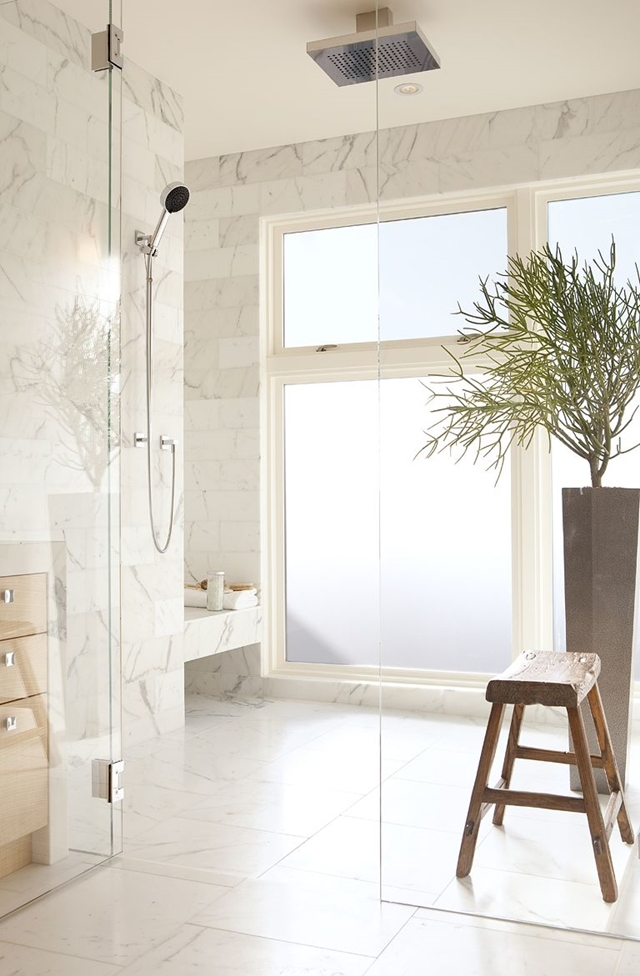 Glass shower-cabin with a wooden chair inside
