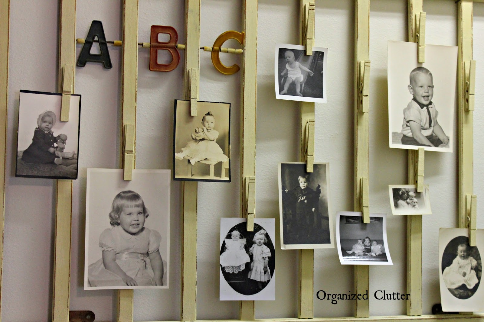 Vintage Crib Rail Wall Photo Display www.organizedclutter.net