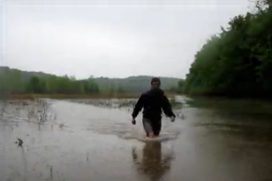 Aaron Fanetti hiking through flood waters