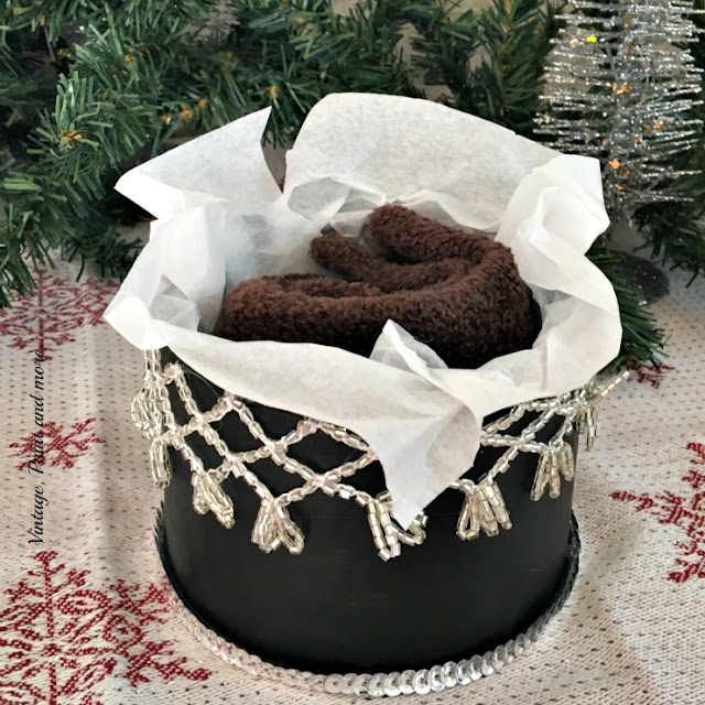 gift in recycled nut can