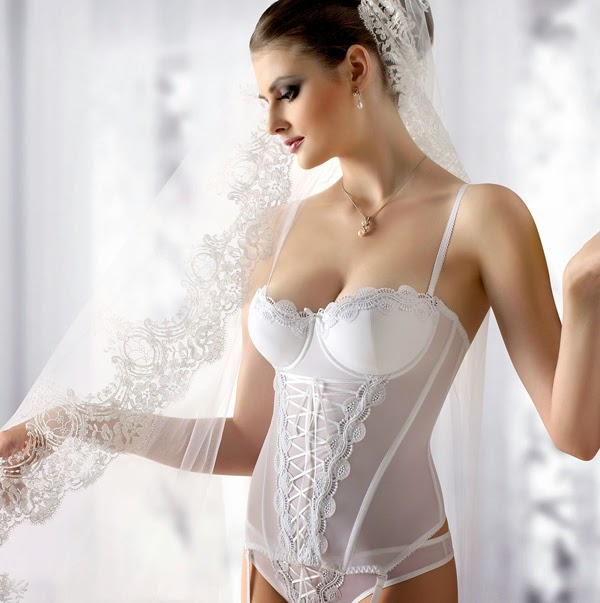 Ask the consultant at the bridal shop about what type of lingerie will flatter your figure best. Also, don't forget to pay attention to the structure of the gown: look whether it has boning or built-in cups. The dress may have the unusual cut or the transparent material. Those are the details that will influence your choice of certain lingerie type. You can avoid this problem by simple buying your wedding gown first and then finding the lingerie set that will suit your dress. Other way is purchasing the lingerie set at the store with a loyal return policy and then choosing the dress by trying it on the lingerie.