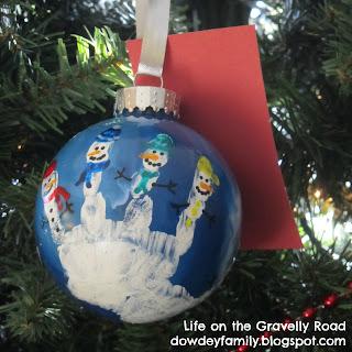 handprint and snowmen ornament