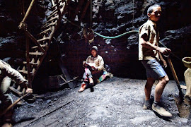 child reading in a mine