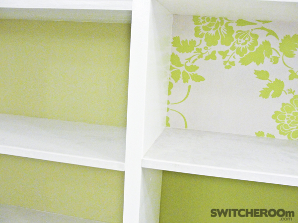 chic office, green office, green, shelves, cut-out chandelier, white floors, office renovation, open shelves, ornate mirror