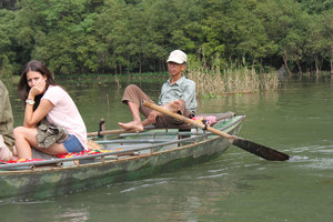 Local boat rower using his feet