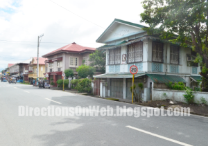 Row of Spanish houses along national road of Pila Heritage Town