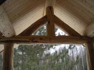 log truss from inside the covered entry, http://huismanconcepts.com/