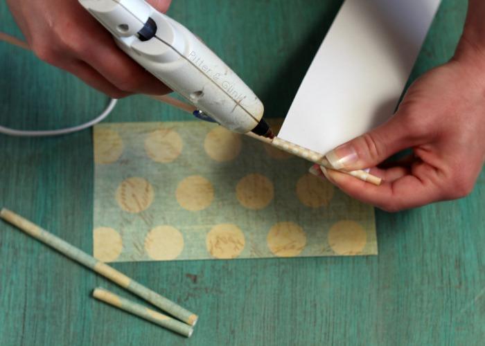 Use scrap paper, a dowel and hot glue to create rolled paper tubes. pitterandglink.com