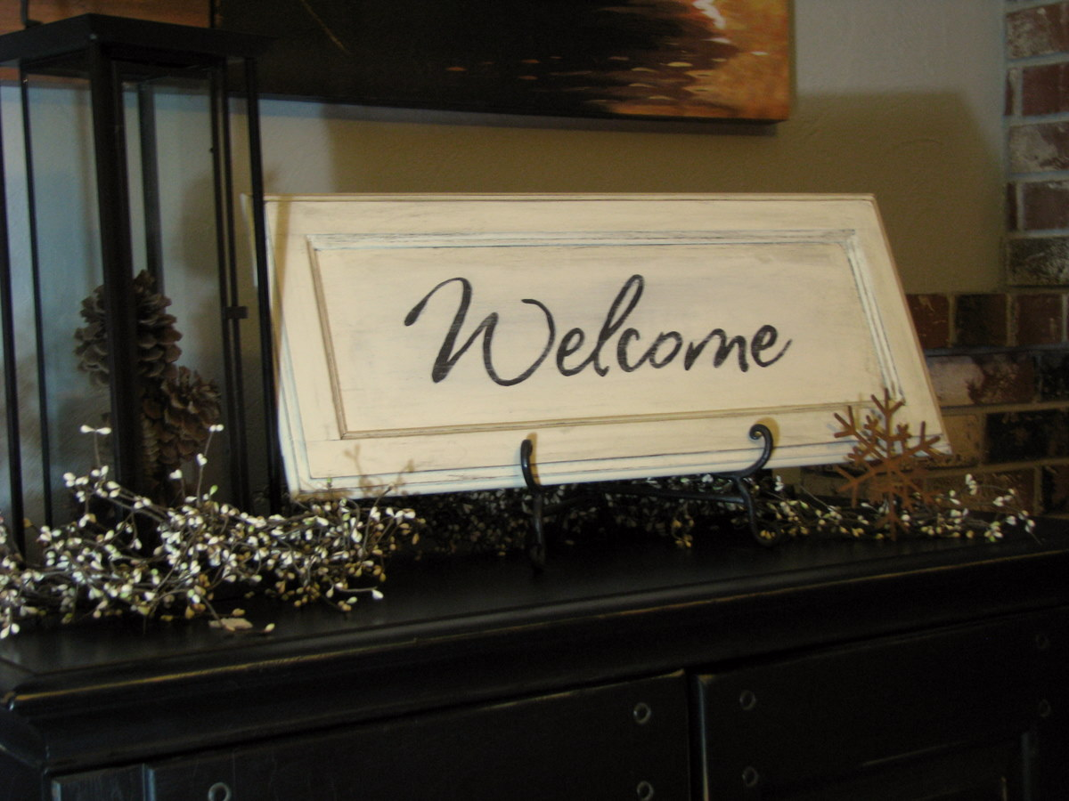 Blue Roof Cabin Welcome Sign Out Of Cabinet Door