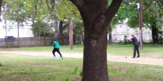 """Police Officer"" Michael Slager executes Walter Scott with multiple shots to Scott's back. Slager claimed he was ""defending himself"" and almost got away with this standard police cover up. — Until a video emerged which proved it was cold blooded murder. (Photo screen captured from video)"
