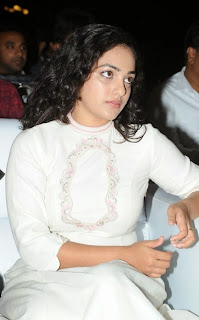 Actress Nithya Menen Pictures in White Long Dress at Malli Malli Idi Rani Roju Audio Launch  31