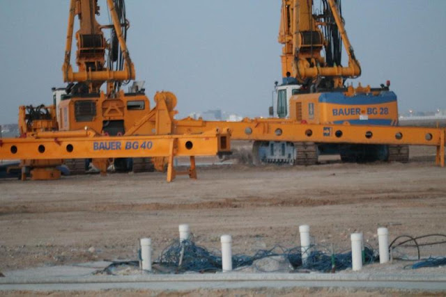 Picture of two yellow piling machines on the Kingdom Tower construction site