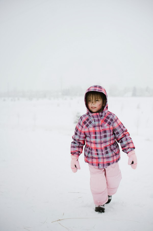 girl walking up the snowy hill