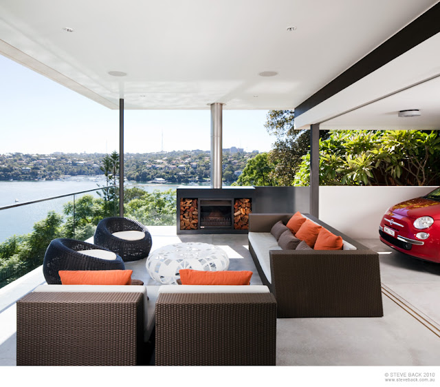 Terrace with fireplace in the River House by MCK Architects