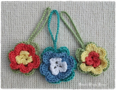 flowers,crochet, small,tiny,cute,pretty,embellishments,key rings, bag charms.