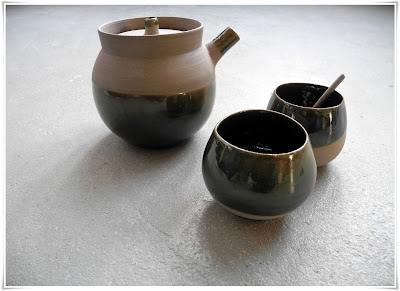 Grey stoneware pottery with green glaze