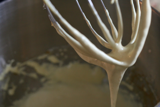 Picture of glossy meringue dripping from a whisk.