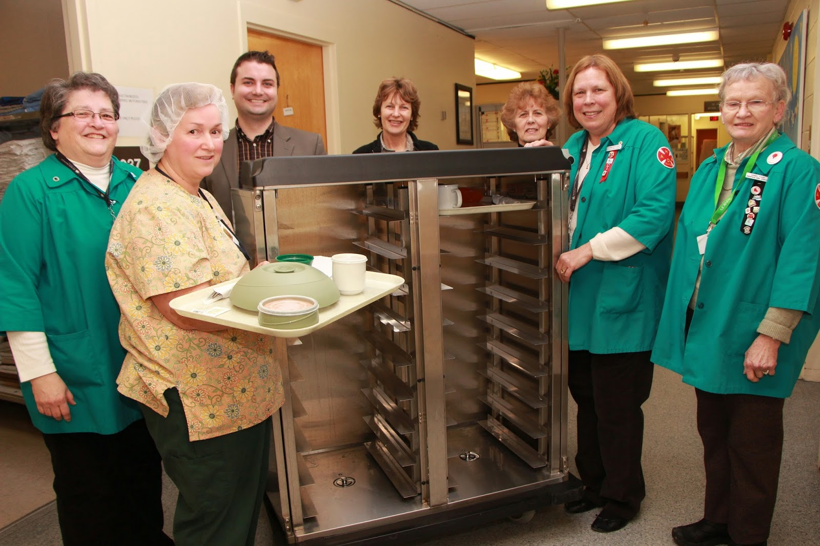 Staff and volunteers celebrate the food service improvements at Huntsville District Memorial Hospital Site
