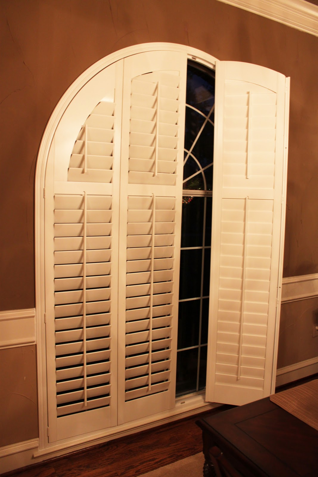 Trinity uptown window coverings custom shutters arched bi fold shutters for Bifold interior window shutters