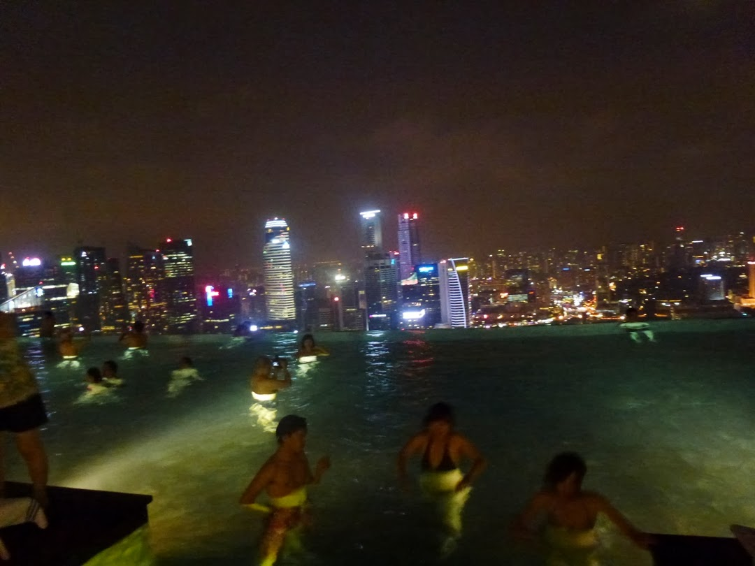 infinity pool singapore night. The Singapore Skyline View From 57th Floor Infinity Pool At Marina Bay Sands Night R