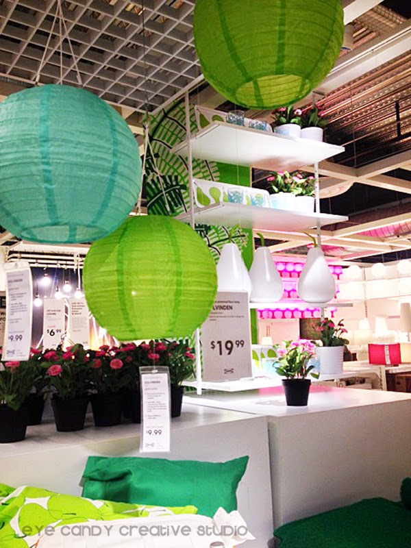 outdoor solar lights, paper lanterns, potted flowers, outdoor pillows