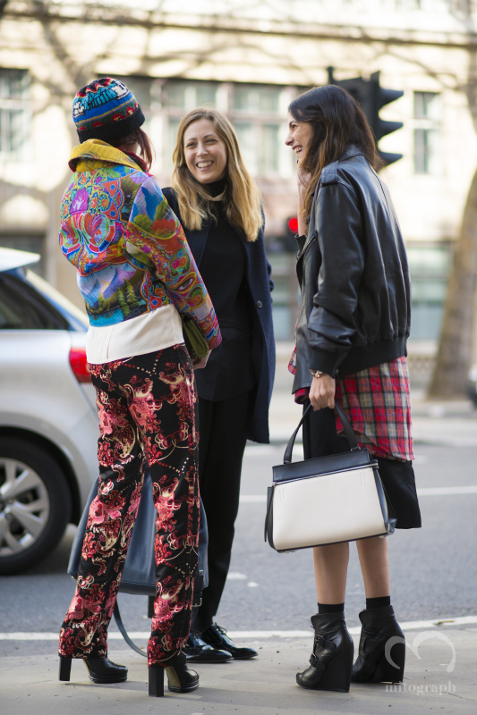 Women talking infront of Sommerset house during London Fashion Week 2014 Fall Winter LFW